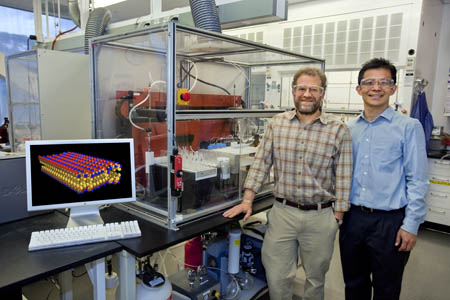 Ron Zuckermann (left) and Ki Tae Nam with Berkeley Lab�s Molecular Foundry, have developed a �molecular paper� material whose properties can be precisely tailored to control the flow of molecules, or serve as a platform for chemical and biological detection (Photo by Roy Kaltschmidt, Berkeley Lab Public Affairs).