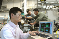 Assistant physicist Zhang Jiang (from left) examines a X-ray diffraction as physicist Jin Wang and nanoscientist Xiao-Min Lin prepare a sample at one of the Advanced Photon Source�s beamlines. The Argonne scientists have examined nanoparticle crystallization in unprecedented detail using the high powered X-rays of the APS.
