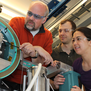Thomas Proffen, left, of Los Alamos National Laboratory, and Peter Chupas and Karena Chapman of Argonne National Laboratory examine the high-energy X-ray beamline 11-ID-B at Argonne's Advanced Photon Source facility.