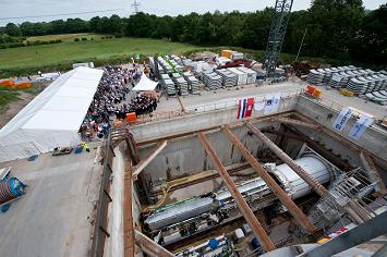 First tunnel and borer christening ceremony on the European XFEL construction site Schenefeld on 30 June 2010. In the foreground the tunnel boring machine in its start shaft. (Photo: European XFEL)