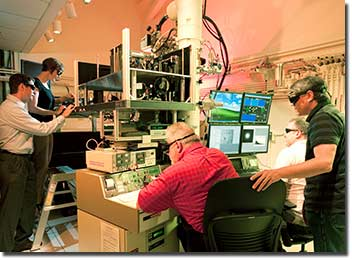 Working with the dynamic transmission electron microscope (DTEM). From left: Bryan Reed, Melissa Santala, William DeHope, Thomas LaGrange, Joseph McKeown.