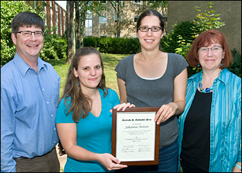 With the Goldhaber Award winner Johanna Nelson (second from left), are (from left) her advisor, Chris Jacobsen, Argonne National Laboratory and Northwestern University; Anne Sickles, a former Goldhaber Award winner who is currently an assistant scientist at Brookhaven Lab�s Physics Department; and Linda Bowerman, Brookhaven Women in Science.