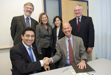 CHN Director Ahmed Busnaina (bottom, left) joins NIOSH Director John Howard and other collaborators to sign the agreement. Photo by Mary Knox Merrill.