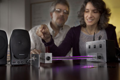 Jim Overhiser, former physics teacher in residence in the Cornell PhysTec program, and Julie Nucci, director of education programs at the Center for Nanoscale Systems, demonstrate a science exhibit called Converting Light to Music. Robert Barker/University Photography