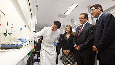 PhD student Sean Muir, AIBN�s Dr Denisa Jurcakova, Dow chairman and CEO Andrew Liveris and Professor Max Lu