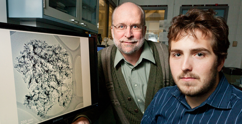 Civil and environmental engineering professor Mark Rood (left) and graduate student John Atkinson developed a novel method of producing porous carbon spheres with iron dispersed throughout them for catalytic and air quality applications. Photo by L. Brian Stauffer