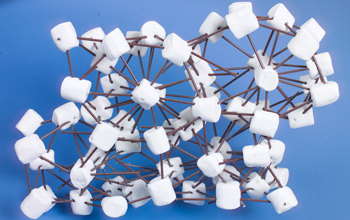 Marshmallows connected with coffee stirrers represent hairy spheres in a crystal structure.