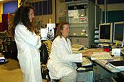 LLNL's Jennifer Pett-Ridge, right, runs the NanoSIMS and analyzes some arsenic-grown cells from Mono Lake as NASA/USGS's Felisa Wolfe-Simon observes.