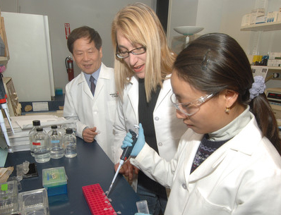Peixuan Guo, PhD, Dane and Mary Louise Miller Endowed Chair in biomedical engineering with students in his lab at the Vontz Center for Molecular Studies