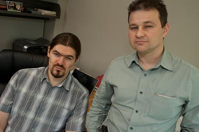 Rice graduate student Alexey Akimov, left, and Anatoly Kolomeisky, associate professor of chemistry, have taken a large step toward defining the behavior of molecules attached to a gold surface.  (Credit Jeff Fitlow/Rice University)