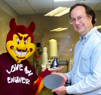 ASU materials science and engineering professor James Adams and ASU Sun Devils mascot Sparky display new materials in a university research lab. Photo: Jessica Slater/ASU