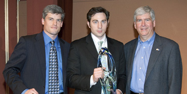 From left to right: U-M Technology Transfer mentor Nick Cucinelli, left, with first place winner Nick Moroz and Gov. Rick Snyder U-M Photo Services / Eric Bronson