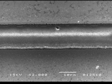 This image, taken with a scanning electron microscope, shows a microchannel that was created using an ultrafast-pulsing laser.