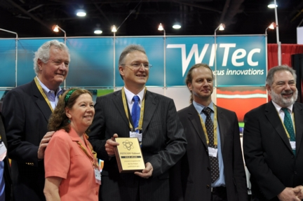 The image shows (from left to right) Dr. Robert Stevenson, Dr. Eileen Skelly Frame (Editors American Laboratory), Dr. Joachim Koenen (Managing Director WITec), Harald Fischer (Marketing Director WITec), Bob Hirche (Managing Director WITec Instruments Corp. USA)