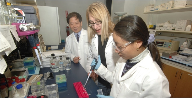 Peixuan Guo, PhD, Dane and Mary Louise Miller Endowed Chair in biomedical engineering with students in his lab at the Vontz Center for Molecular Studies.