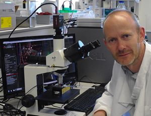 Dr Simon Powis with his NanoSight LM10 system to study exosome behaviour
