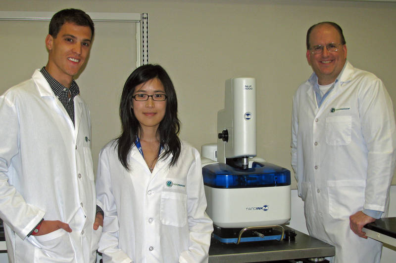 From Left to Right: NanoProfessor Interns Troy Blume and Da In Lee with Dr. John Ireland, Director of the NanoProfessor Program and NanoInk's NLP 2000 Desktop Nanofabrication System.