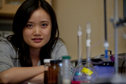 Rice University graduate student Wei Gao is researching ways to enhance plain sand with nanomaterials to improve its ability to remove contaminants from water. (Credit: Jeff Fitlow/Rice University)