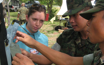DayOne Response, a student team funded by the National Collegiate Inventors and Innovators Allianc NCIIA in 2009, has developed a water storage/purifcation system for use in disaster relief. Here, DayOne founder and waterbag inventor Tricia Compas demonstrates the waterbag to members of the Thai military. The waterbag was tested in a joint exercize between U.S. and Thai military forces in 2010.