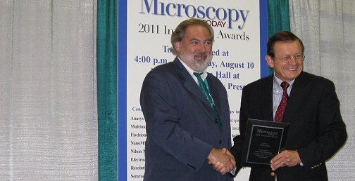 WITec US Managing Director Bob Hirche receives the Microscopy Today Innovation Award 2011 from Microscopy Today Editor in Chief Charles Lyman.