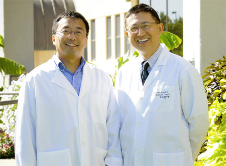 Michael Wang, MD, PhD, right, assistant professor of pathology and anatomical sciences, and Li-Qun Gu, PhD, associate professor of biological engineering, have developed a new technology for the early detection of lung cancer. Worldwide and in the United States, lung cancer is the most common cause of cancer-related death.
