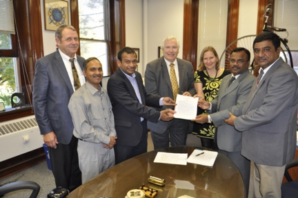 MU officials held a signing ceremony with K.S.R. Educational Institutions of India. Pictured, from L-R: Henry White, professor emeritus of physics; Raghuraman Kannan, MU assistant professor of radiology; R. Srinivasan, K.S.R. vice chancellor, international programs; Rob Duncan, MU vice chancellor for research; Annette Sobel, MU assistant to the provost for strategic opportunities; V. Rajendran, K.S.R. vice chancellor of research; K. Balaji, K.S.R. estate manager.
