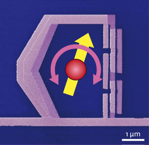 Figure 1: An electron micrograph of the artificial atom. A superconducting loop of metal is interrupted by non-superconducting Josephson junctions. The current can flow clockwise or counterclockwise around the loop, and are analogous to the electron spin of a real atom (yellow arrow). The horizontal wire along the bottom of the atom can be used to excite the atom, and to measure its emission.