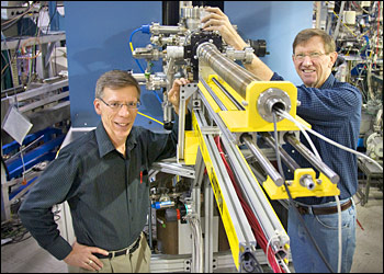 Dan Fischer (left) and Raymond Browning show off the prototype of the Vector Potential Photoelectron Microscope.