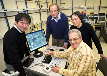 (From left) Brookhaven National Laboratory chemists Kotaro Sasaki, Radoslav Adzic, Jia Wang, and Miomir Vukmirovic work on the recently licensed electrocatalysts using a new electron microscope in their laboratory.