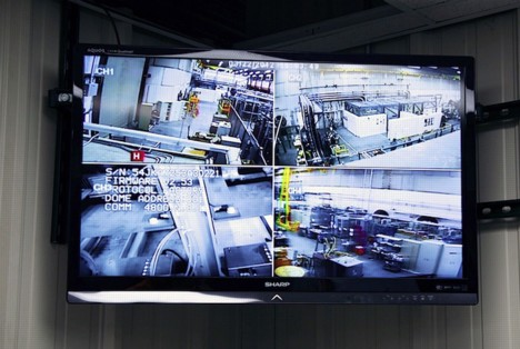 A control room screen offers images of the magnet area.