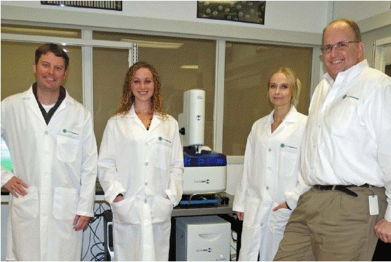 Pictured from Left to Right with NanoInk�s NLP 2000 Desktop Nanofabrication Instrument are Dr.