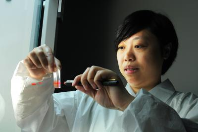 Dr. Huo works with nanoparticles in her lab at the University of Central Florida in Orlando.