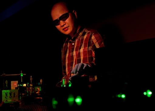 Vertical-cavity surface-emitting laser Colloidal quantum dots � nanocrystals � can produce lasers of many colors. Cuong Dang manipulates a green beam that pumps the nanocrystals with energy, in this case producing red laser light. Credit: Mike Cohea/Brown University