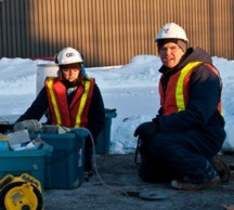 Dr Denis O'Carroll and colleagues at groundwater test site in Ontario, Canada