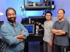 Iowa State University and Ames Laboratory researchers, left to right, Sanjeevi Sivasankar, Chi-Fu Yen and Hui Li have invented microscope technology to study single biological molecules. Larger photo. Photo by Bob Elbert.