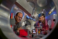 Sasi Palaniyappan (right) and Rahul Shah (left) inside a target chamber where the TRIDENT short pulse laser is aimed at a very thin foil target.