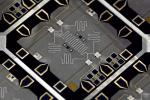 The device used to run the first solid state demonstration of Shor's algorithm. It is made up of four phase qubits and five superconducting resonators, for a total of nine engineered quantum elements. The quantum processor measures one-quarter inch square.