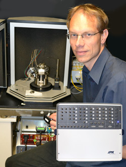 Dr Bart Hoogenboom from UCL with his advanced AFM set up controlled by JPK's Vortis system (insert)