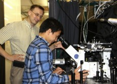 Dr. Anton Malko (left) works in the lab with Hue Minh Nguyen, a physics graduate student who has assisted in the research.