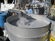 Chemical engineer Paul Edmiston demonstrated Osorb®, a revolutionary new type of material that can clean water from oil spills, detect explosives and even treat the subsurface of Superfund sites, during a webcast hosted by NSF last year. Pictured are Dr. Stephen Jolly and Doug Martin of ABSMaterials showing clean water being passed over a vibratory separator after treatment with Osorb®. Find out more in this webcast video.