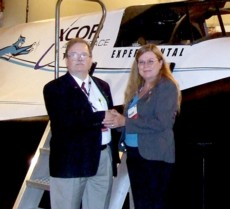 Dale Amon, NSS Archivist, and Kathy Harper, NMMSH Marketing & Public Relations in front of the Lynx I Spaceplane mock-up at the 2012 International Symposium for Personal and Commercial Spaceflight conference in Las Cruces