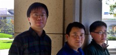 Professor Shanhui Fan (center), post-doctoral scholar Zongfu Yu (right), both of the Stanford School of Engineering, and doctoral candidate Kejie Fang (left), of the Department of Physics, have used synthetic magnetism to control the flow of light at the nanoscale. Photo: Norbert von der Groeben.