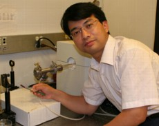 Chongwu Zhou holds up a piece of plastic substrate used to build nanoscale transistors and circuits.