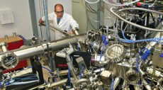 Brookhaven Lab physicist Ivan Bozovic with the molecular beam epitaxy system he uses to engineer atomically precise superconducting materials.