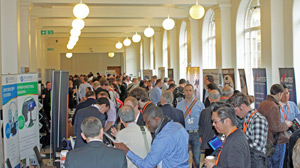 Delegates take time out at the exhibition.