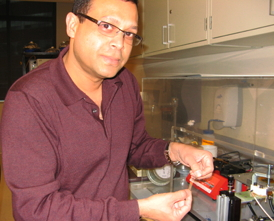 Dr. Alamgir Karim holds a strip of the polymer thin film that can now be produced at an industrial level for use in a wide range of applications.