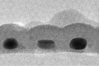 This is a cross-section of the record-thin absorber layer showing three gold nanodots, each about 14x17 nanometers in size and coated with tin sulfide.