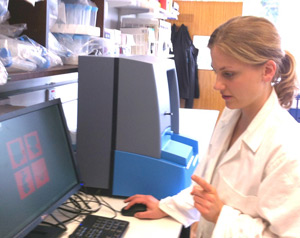 Michelle Levene, a PhD student of the Clinical Sciences Division at St Georges uses the NanoSight LM10 NTA system used to characterize proteins and peptides.