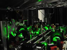 Part of the optical system used to trap and manipulate atoms. The arrangement of mirrors and lenses brings the a large number of laser beams onto the atoms. Photo : Jean-Philippe Brantut / ETH Zurich