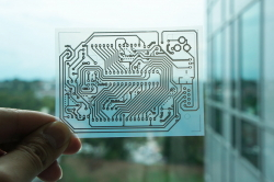 A single-sided wiring pattern for an Arduino micro controller was printed on a transparent sheet of coated PET film.